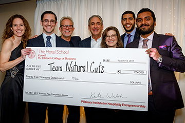 Team holding a large check at BPC 2017