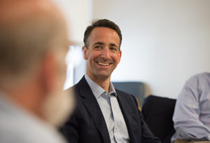 Man smiling at the NYC and San Francisco regional roundtables 2016