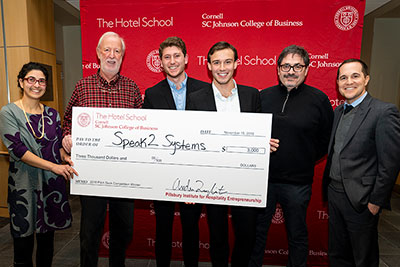 The Speak2 Systems group accepting the first place check.