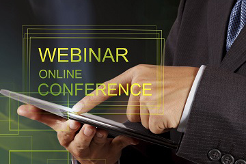 Person touching a smartphone with the words webinar online and conference
