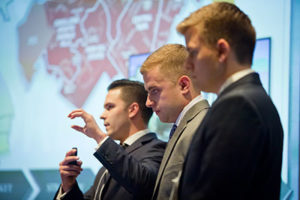 Group speaking at the Cornell Real Estate Case competition
