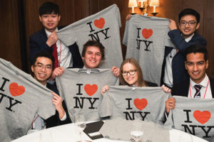 "Group of international students holding up ""I heart NY"" shirts"