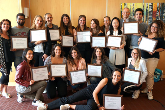 Staff from ESCP, Madrid holding certificates with staff from the Office of Executive Education