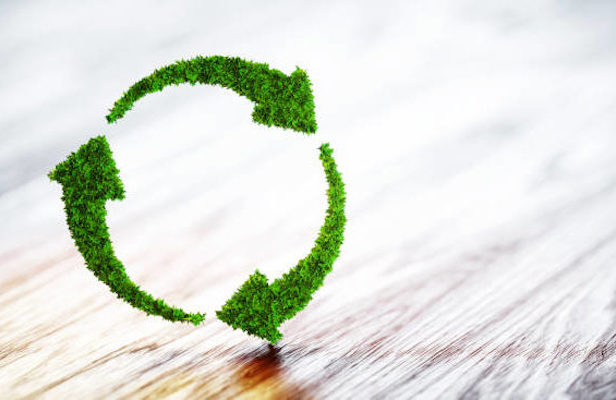 Recycling icon made of grass
