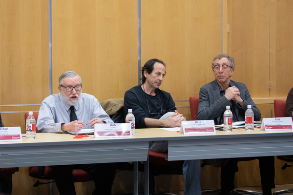 Professors in a roundtable discussion.