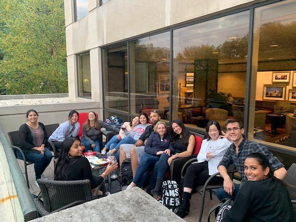 MMH students sit outside on a patio socializing