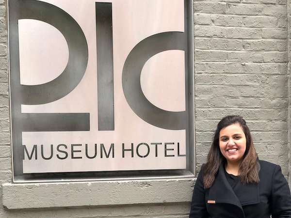 Anushae standing in front of a 21C Museum sign