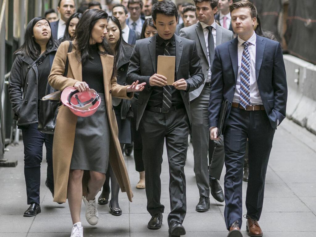 real estate grad students walking inside large building
