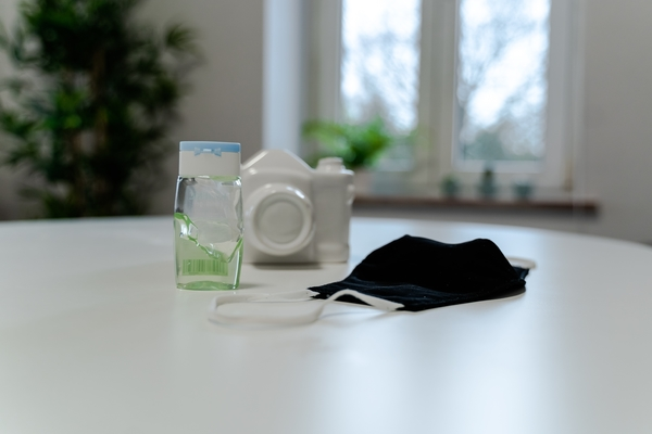 Image of mask and hand sanitizer