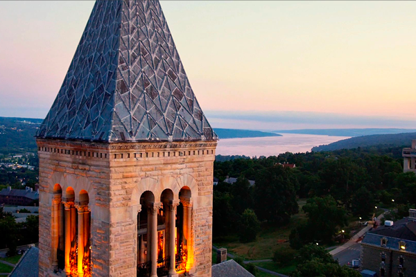 mcgraw tower with aerial view of campus and lake