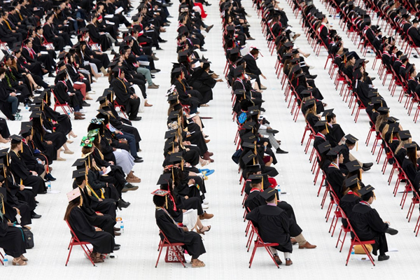 rows of graduates at commencement