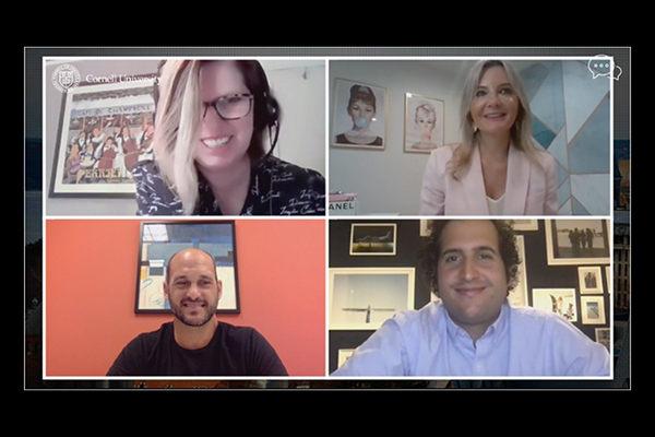 A screenshot, showing the four webinar panelists smiling during the online event.
