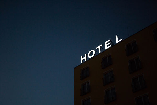 hotel sign lit up at night on building