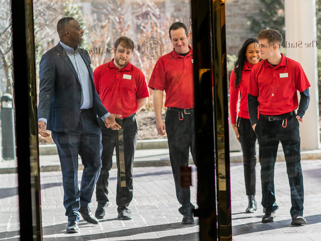 Students photographed through the glass door at The Statler Hotel while they work