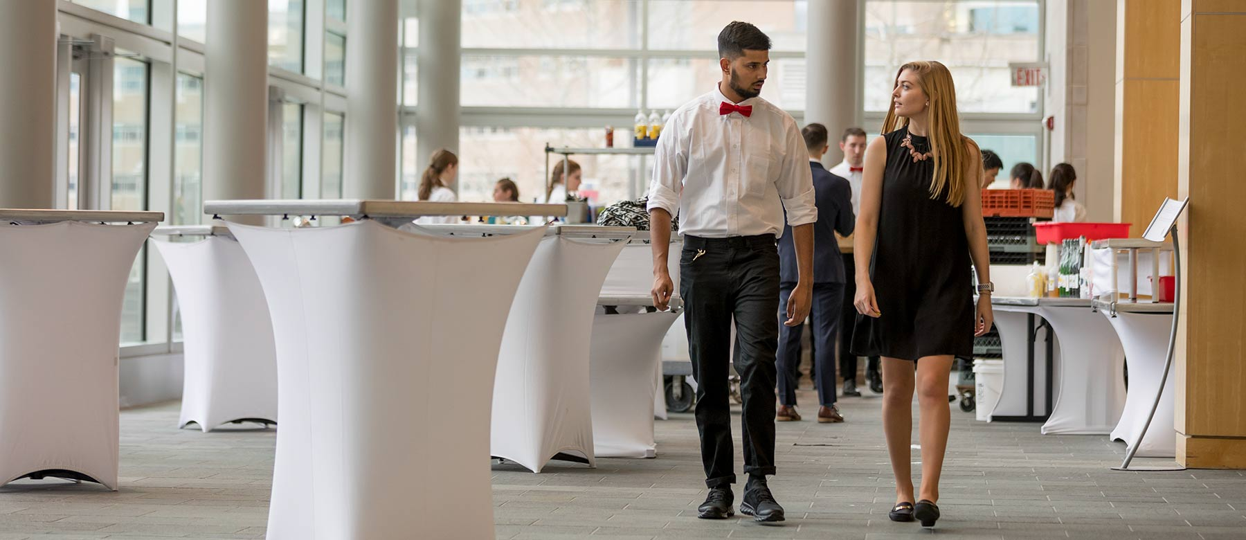 Two students walking in business attire