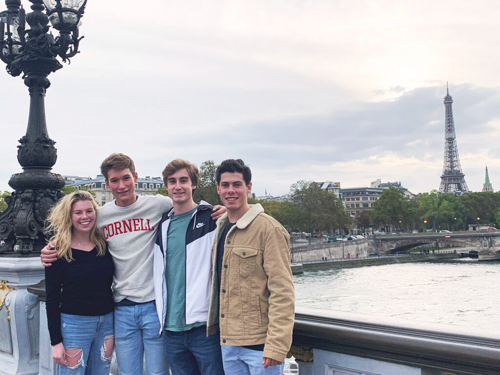 Students pose in front of the Eiffel Twoer