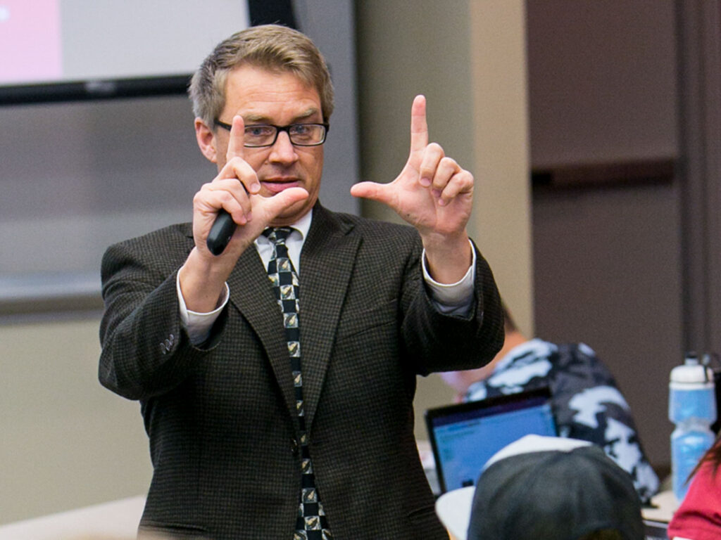 Professor speaking in front of a class