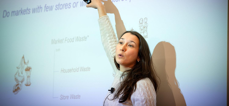 Professor Belavina speaking in front of a class