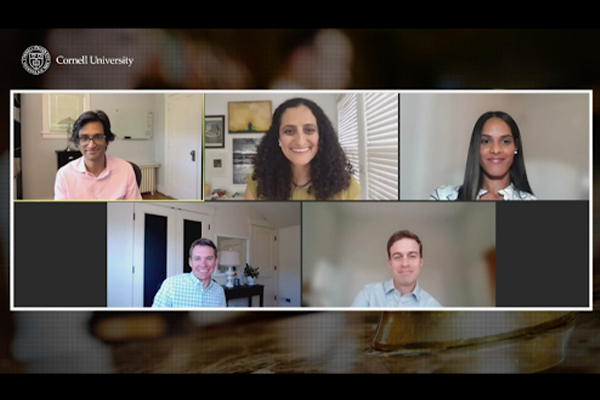 A screenshot, showing the five webinar panelists smiling during the online event.